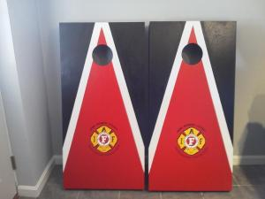 corn hole hagning around the fire house